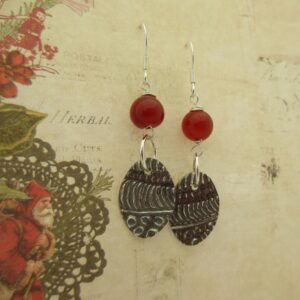 Handcrafted silver earrings with red quartz