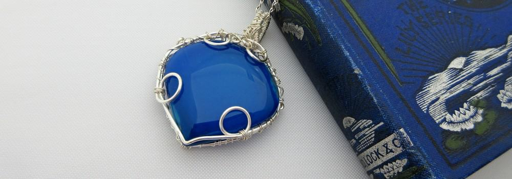 Bright blue agate pendant with silver plated wire wrap detail