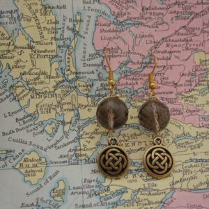 Drop Earrings with Smokey Quartz and gold plated celtic knotwork charms. Designed and created in the Isle of Skye