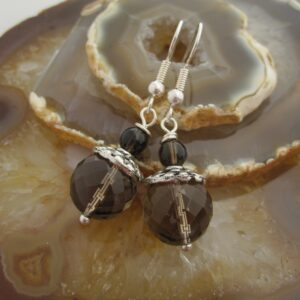 Drop earrings with facet cut smokey quartz and silver plated bead caps. Designed and created in the Isle of Skye.